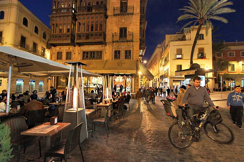 Street cafes in Seville, Spain comes alive at night