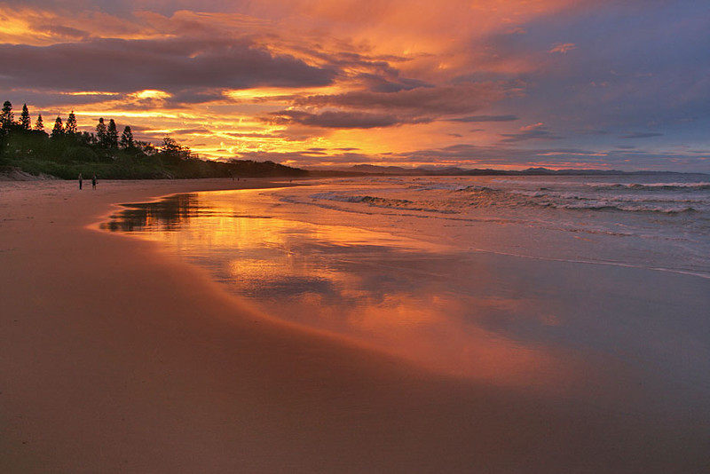 Sunset in Byron Bay, Australia, turns sand gold