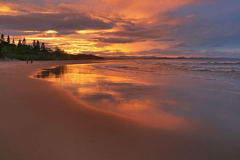 Sunset in Byron Bay, Australia, turns sand gold