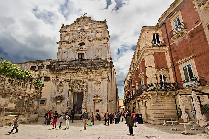 The Church of Santa Lucia alla Badia, with its baroque with rococo elements on the facade, anchors one end of exquisite Piazza Duomo in Syracuse, Sicily. It is home to one of Siracusa's most prized works of art, The Burial of Santa Lucia by Caravaggio.