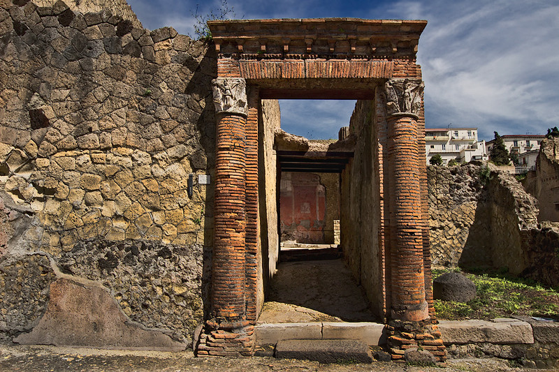 Magnificent portal at Herculaneum leads to stunning wall frescoes in ruined house
