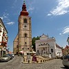 The Town Tower and Ptuj Town Theater on Slovene Square in Ptuj, Slovenia. The Orpheus Monument, a carved marble Roman tombstone that stands in front of the tower, is probably from the second century and is considered the symbol of the town