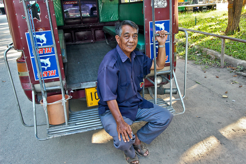 Songtheaw driver in Chiang Mai, Thailand takes a break from delivering passengers