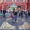 "Visitors at the entrance to Red Square toss coins while standing on ""Zero Kilometer,"" the place from which all distances in Moscow are measured."
