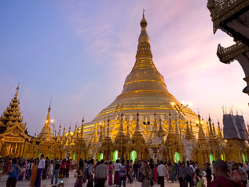 Sunset at Shwedagon Pagoda. As the sun dips, this most famous of Buddhist sites in Yangon, Myanmar, begins to glow as if illuminated from within.