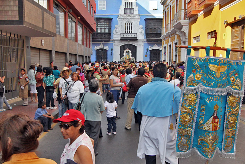 Worshipers carry icon of Virgen de la Puerta through the streets of Lima, Peru