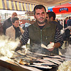 Vendor at the fish market near Galata Bridge serves up Fresh-caught Mackerel sandwiches