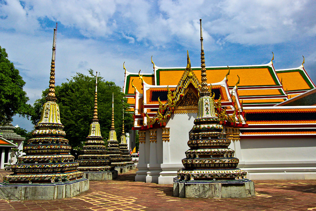 Sun glints off golden finial at Wat Pho in Bangkok, Thailand, famous for its giant reclining Buddha
