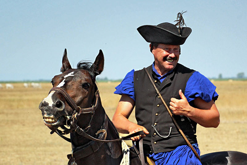 They say people look like their pets.Does this traditional herdsman in the Hungarian puszta resemble his horse?