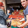 Sampling fresh homemade foccacia at the daily market on the island of Ortigia, home to the Old Town of Syracuse, Sicily