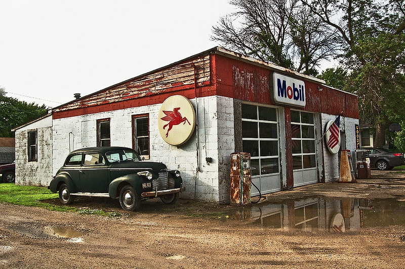 Old Mobile Gas Station on U.S. Route 66 in Odell, Illinois, complete with rusting pumps and old car