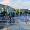 Children romp in the fountain at Promenade du Paillon in Nice, France