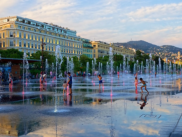 Children romp in the fountain at Promenade du Paillon in Nice, France