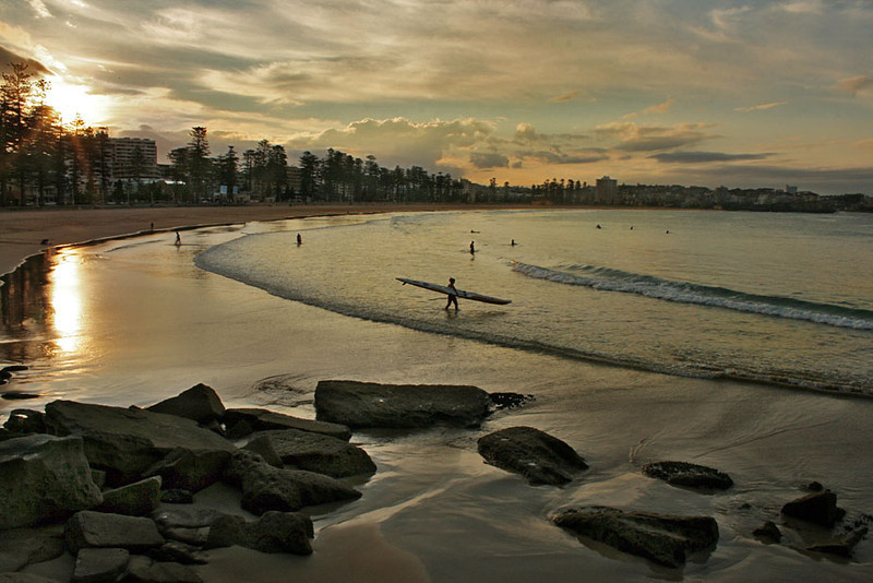 Sun sets over the beach in Manly, Australia