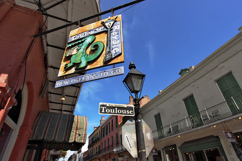Sign and streetlamp at the corner of Toulouse and Royal Streets in the French Quarter of New Orleansy