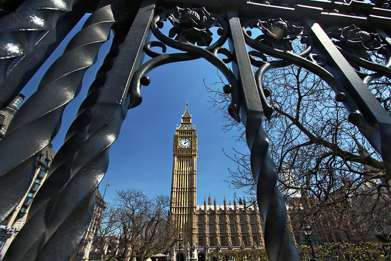 Big Ben, seen through the wrought iron fence of London's Westminster Palace