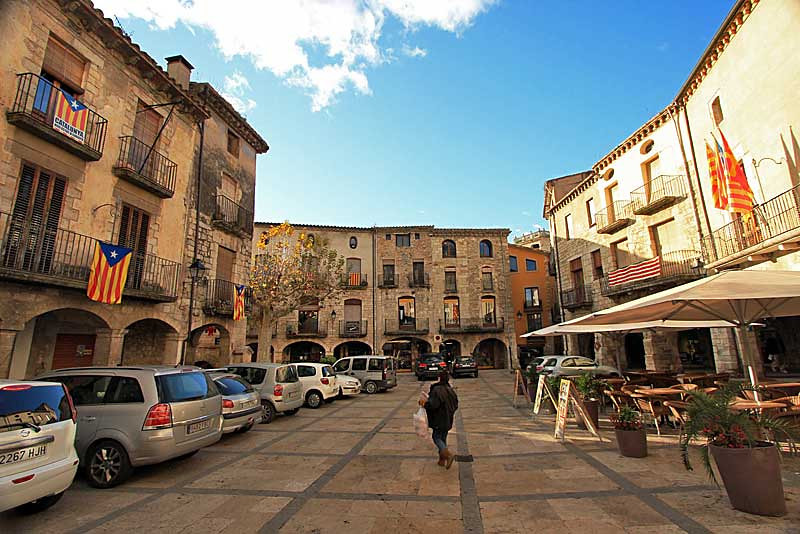 Historic brick and stone buildings on main square in Medieval village of Besalu, Spain