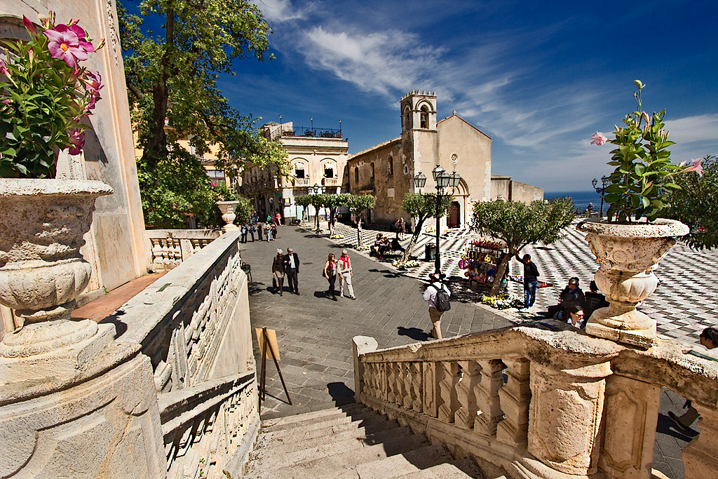 Lovely Piazza IX Aprile in Taormina, Sicily overlooks a crystalline Mediterranean