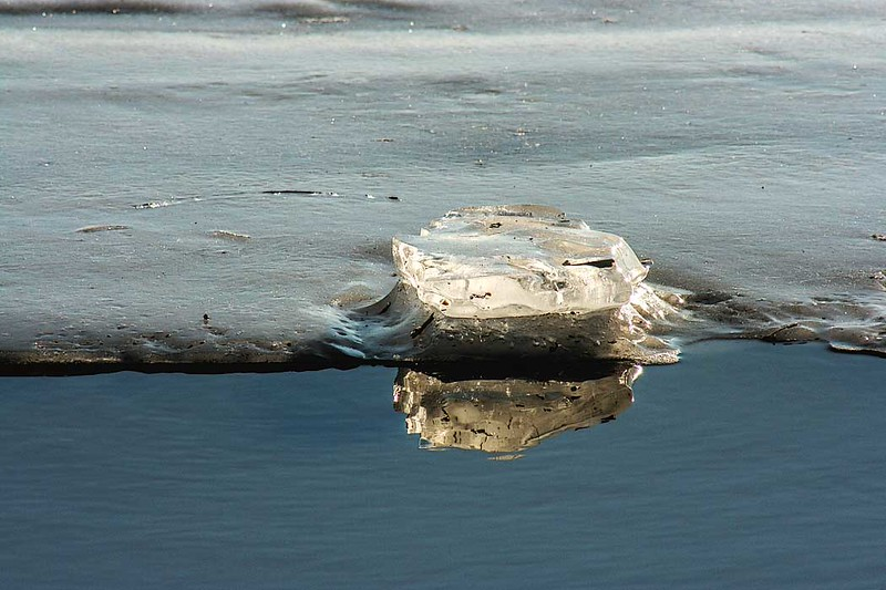 Like a giant cut diamond, this chunk of ice sits on the edge of a melting ice sheet on the Kankakee River in Wilmington, Illinois