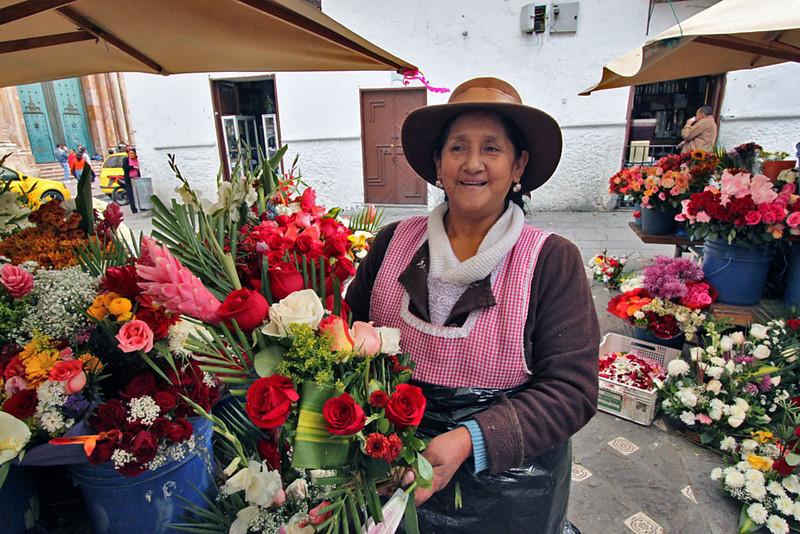 Flower vendor in church square, Cuenca