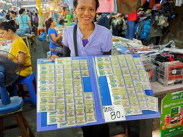 In addition to fresh fruits and vegetables, visitors can purchase Thai lottery tickets at the fresh market at Chiang Mai Gate in Chiang Mai, Thailand