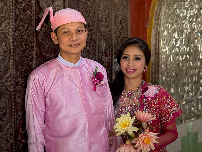 Bridal couple at Kuthodaw Complex in Mandalay, Myanmar, celebrate their wedding day with a visit to the famous temple where each of 729 marble slabs inscribed with Buddhist teachings are housed in its own individual shrine