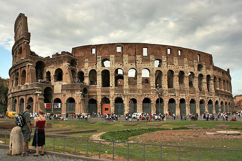 Roman Colosseum, Largest Amphitheater of the Roman Empire, Dwarfs Visitors Standing at its Base