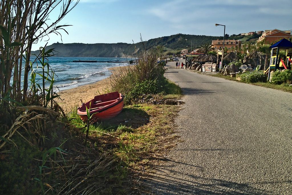 Seafront road along the Mediterranean in the village of Arillas, on the island of Corfu in Greece