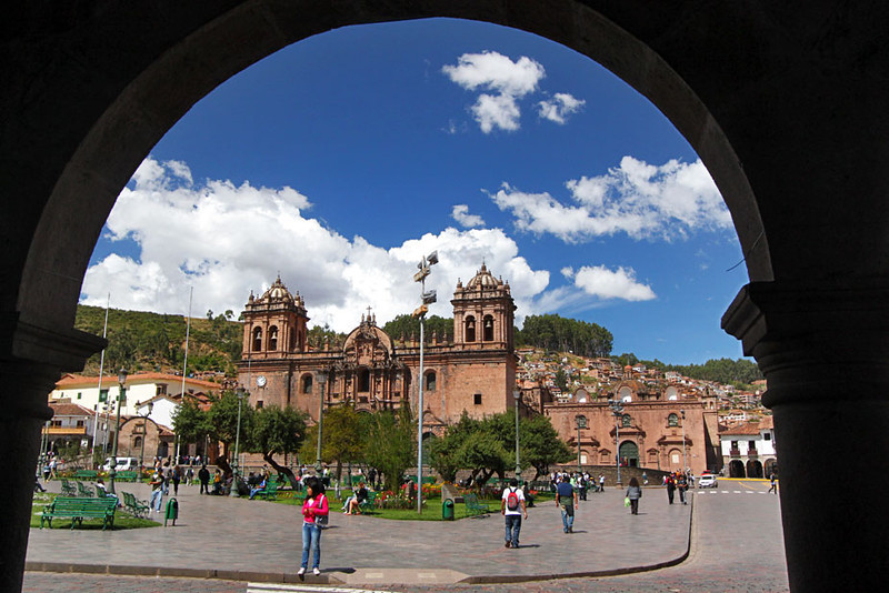 Cusco cathedral framed by arches that surround Cusco's Plaza de Armas