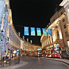 Night lighting at London's Piccadilly Circus shows off the curvature of the buildings