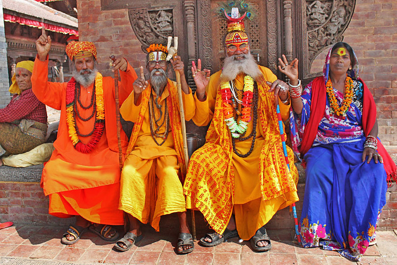 Sadhus pose for photo in Durbar Square, Kathmandu, Nepal