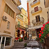 Stairways climb past exquisite shops and residences in Taormina, Sicily, Italy