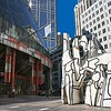 """The James R. Thompson Center in downtown Chicago houses offices of the Illinois state government. The sculpture in front of it is titled """"Monument With Standing Beast."""""""