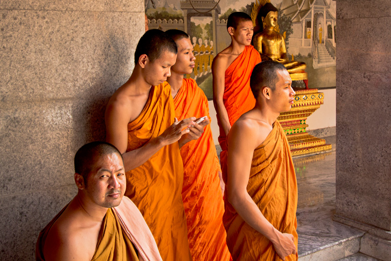 Monks visit the famous Doi Suthep Buddhist temple in Chiang Mai, Thailand