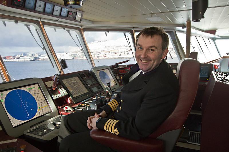 Captain Tommy Eliassen on the bridge of the Hurtigruten's MS Richard With