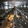 A wooden walkway cut into solid salt walls provides an overview of the Rudolf Mine at Salina Turda Salt Mine