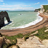 Durdle Door, carved over the eons by battering seas, along the South Coast Path in England's County Dorset