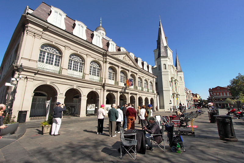 Jazz musicians play in front of the Cabildo Museum and St. Louis Cathedral in New Orleans' Jackson Square