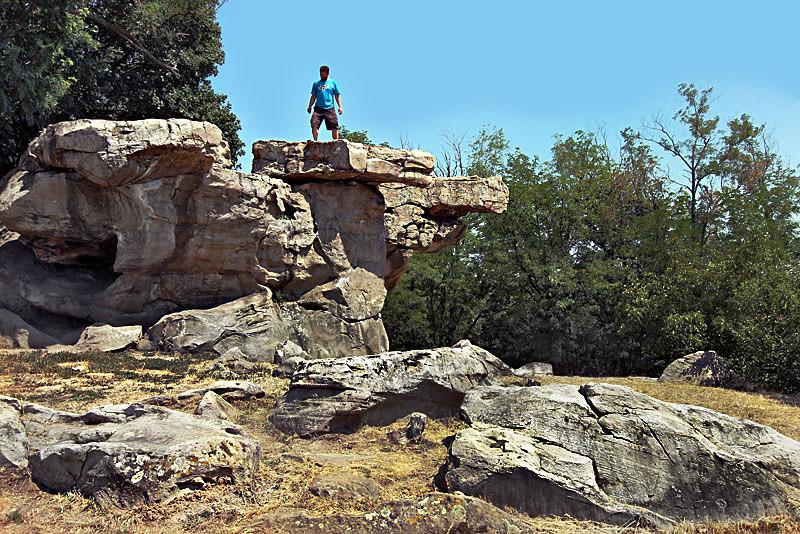 Mammoth balanced stone slabs in the Kali Basin near Lake Balaton, Hungary can be rocked but will not fall