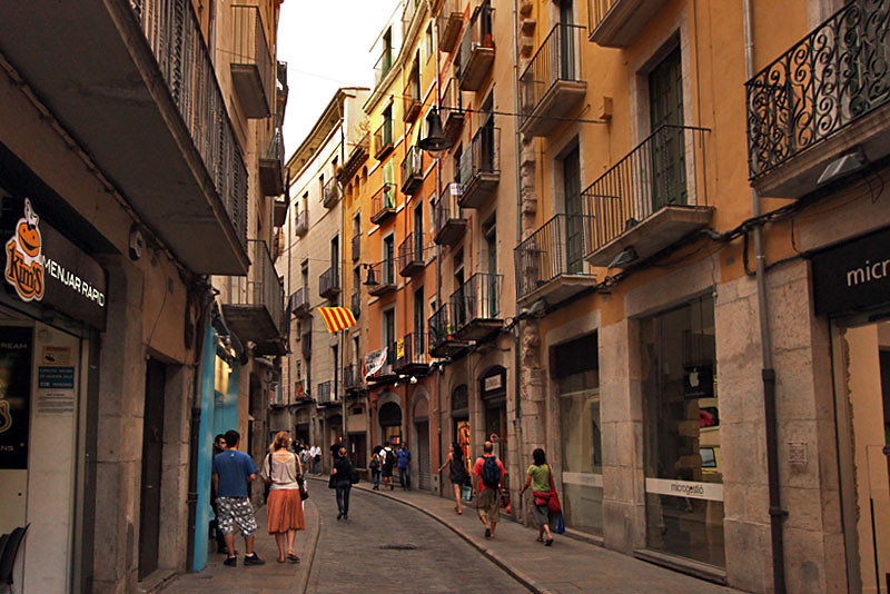 Shopping in Barri Vell (old town) in Girona, Spain