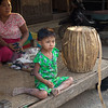Girl from Ohn Ne Kyaung fishing village near Bagan, Myanmar, sits next to a drum made by her family, which specializes in making percussion instruments from locally available materials