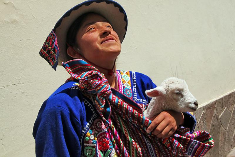 Quichua woman with baby sheep in Cusco, Peru