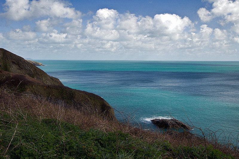 The wild coastline on the South West Coast Path around St. Anthony Head in Cornwall, England