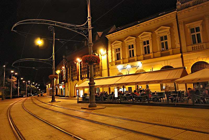 Locals enjoy dining alfresco at street cafes on Kossuth Square in Debrecen, Hungary