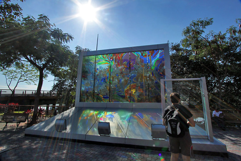 Rainbow sunbeams through sculpture at Malecon Salado in Guayaquil