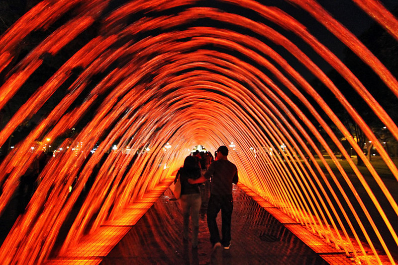 Walking through an archway of water at Parque de Agua in Lima