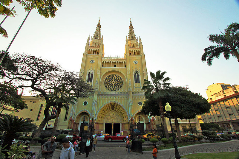 Cathedral of Guayaquil anchors one side of park where iguanas run wild
