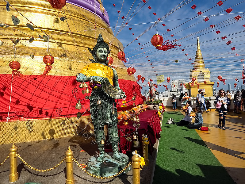 Thais make offerings and pray at the Golden Mount in Bangkok, Thailand on New Year's Day