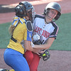 06/03/19 By Gary M. Baranec   Clearfield's Emma Hipps collides with Chestnut Ridge catcher Alex Dunlap in 7th inning action in Ridge's quarterfinal loss to Clearfield Monday at Dubois's Heindl Field.