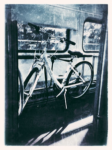 Day 157 - Bike Takes The Train Just a quick iphone shot while riding the train home from work today.  My bike appreciates the lovely accommodations in the bike car.  Edited with Camera Awesome.